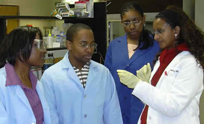Dr. Abraha with her students and technician Doris Gana
