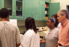 Dr. Joseph Young with TILT students  in the organic chemistry lab.
